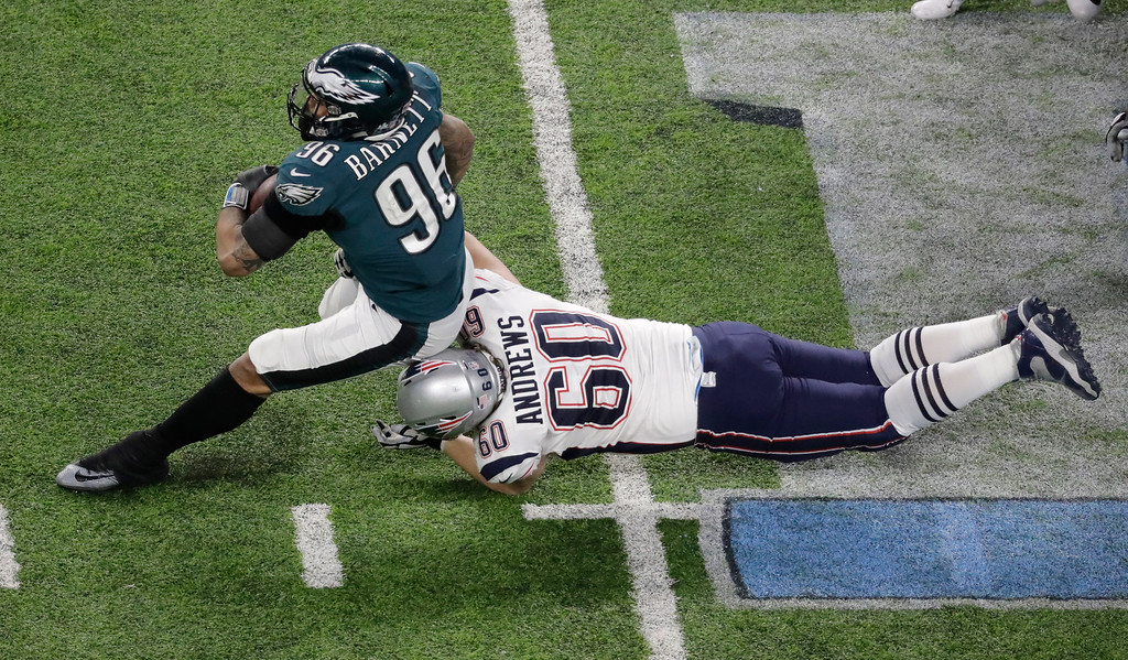 . Philadelphia Eagles defensive end Derek Barnett runs past New England Patriots center David Andrews after recovering a fumble during the second half of the NFL Super Bowl 52 football game Sunday, Feb. 4, 2018, in Minneapolis. (AP Photo/Eric Gay)