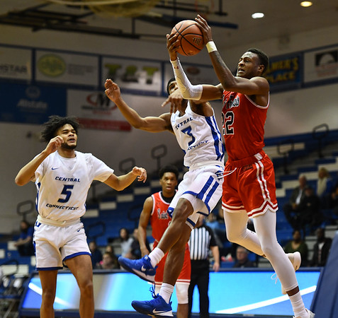 1/4/2020 Mike Orazzi | StaffrCentral Connecticut State University's Ian Krishnan (3) and Saint Francis University's Tyler Stewart (22) during Saturdays mens basketball game in New Britain. rr
