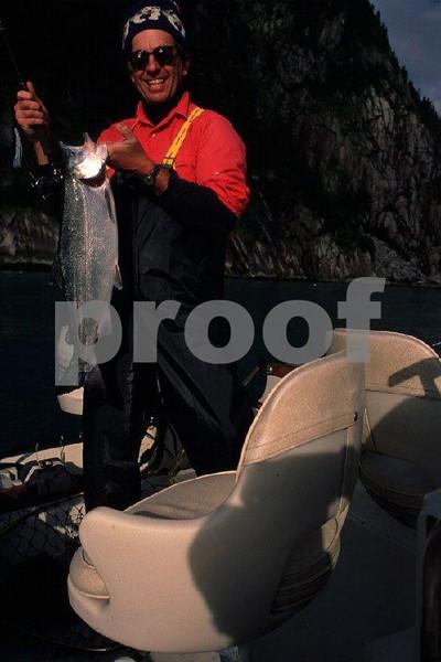 Fisherman with sea caught coho salmon in Seward, Alaska.