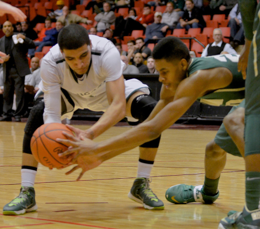 . Jeff Forman/JForman@News-Herald.com Zavier Powers reaches for a lose ball in the fourth quarter of Lake Catholic\'s 68-52 Division II regional semifinal loss March 13 to St. Vincent St. Mary at the Canton Civic Center.