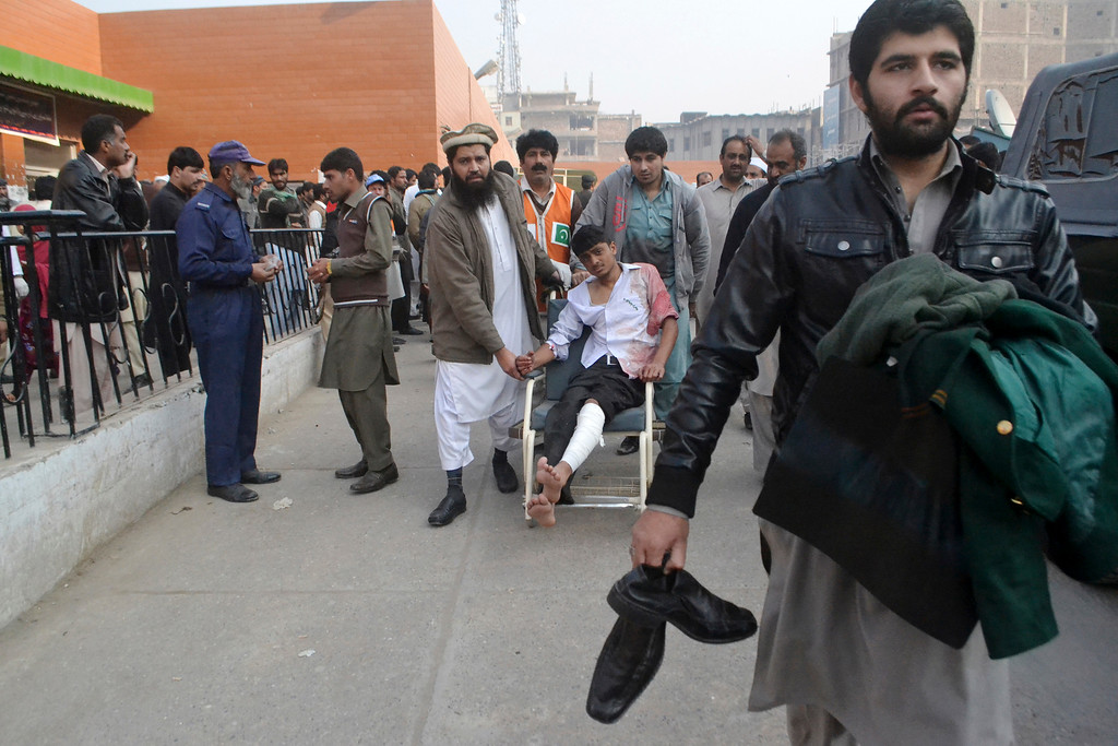 . A Pakistani student, who was injured in a Taliban attack in a school, is brought to a hospital in Peshawar, Pakistan, Tuesday, Dec. 16, 2014. Taliban gunmen stormed a military-run school in the northwestern Pakistani city of Peshawar on Tuesday, killing and wounding scores, officials said, in the highest-profile militant attack to hit the troubled region in months.(AP Photo/Mohammad Sajjad)
