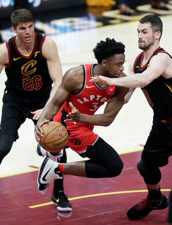 . Toronto Raptors\' OG Anunoby (3), from England, looks to pass against Cleveland Cavaliers\' Kevin Love, right, and Kyle Korver in the second half of Game 4 of an NBA basketball second-round playoff series, Monday, May 7, 2018, in Cleveland. (AP Photo/Tony Dejak)