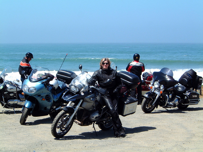 """Ex UK girl, who lives in France takes her R1200GS to America - photo, Brigid, taken on the Pacific Coast Highway in 2006. We flew our bikes into Toronto and were on the road for about 5 weeks: Toronto to Chicago; Chicago to LA (Route 66); then back east via the PCH, Yosemite, ET Hwy, Bryce Canyon UT, Jackson WY, Yellowstone, Cody, Badlands ND, Devil's Tower (remember """"Close Encounters""""?), Sturgis, Deadwood, Mt. Rushmore, Crazy Horse ... then north around Lake Superior, and back to Toronto for a bit of R&R before flying home."""