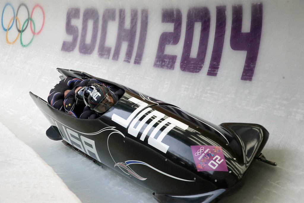. Pilot Steven Holcomb, Curtis Tomasevicz, Steven Langton and Christopher Fogt of the United States team 1  a run during the Men\'s Four-Man Bobsleigh on Day 16 of the Sochi 2014 Winter Olympics at Sliding Center Sanki on February 23, 2014 in Sochi, Russia.  (Photo by Adam Pretty/Getty Images)