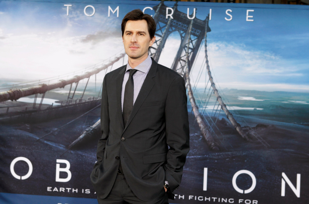 """. Director Joseph Kosinski poses at the premiere of his new film \""""Oblivion\"""" in Hollywood, California April 10, 2013.  REUTERS/Fred Prouser"""