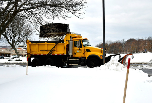 12/4/2019 Mike Orazzi | Staff City public works crews remove snow from Riverside Avenue in Bristol on Wednesday while cleaning up from the most recent storm.