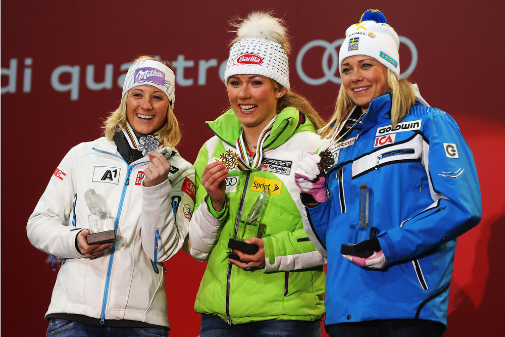. Race winner Mikaela Shiffrin (C) of the United States of America celebrates with second placed Michaela Kirchgasser (R) of Austria and third placed Frida Hansdotter (R) of Sweden at the medal ceremony following the Women\'s Slalom during the Alpine FIS Ski World Championships on February 16, 2013 in Schladming, Austria.  (Photo by Alexander Hassenstein/Getty Images)