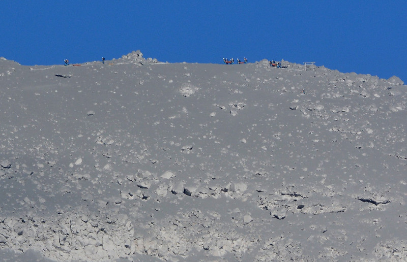 . Rescue teams climb the ridge of a mountain covered with volcanic ash from Mount Ontake in Nagano prefecture on September 29, 2014.  Firefighters, police and troops resumed search operations on a volcano in central Japan after four confirmed fatalities with at least 27 other people feared dead.   KAZUHIRO NOGI/AFP/Getty Images