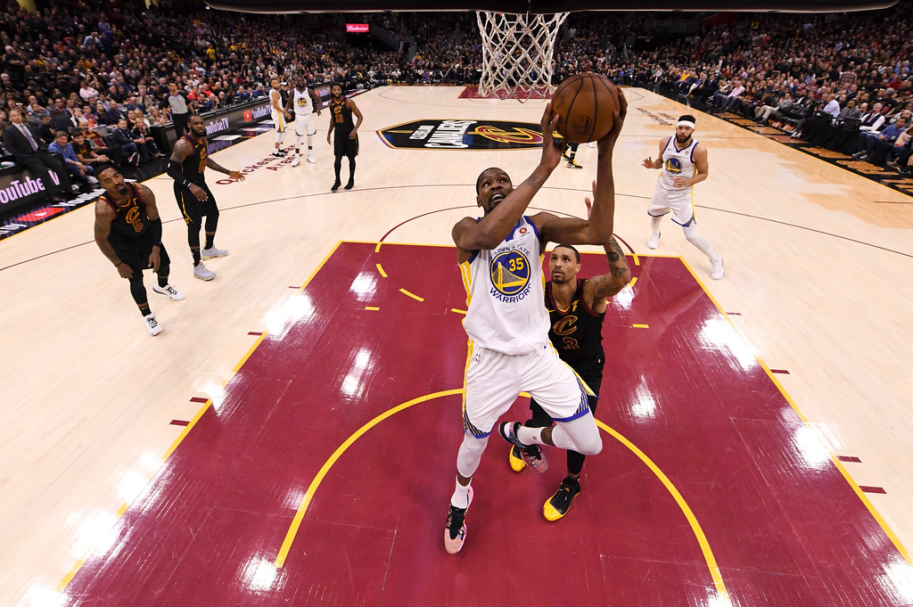 . Golden State Warriors forward Kevin Durant (35) shoots in front of Cleveland Cavaliers guard George Hill (3) in the second half of Game 3 of basketball\'s NBA Finals, Wednesday, June 6, 2018, in Cleveland. The Warriors defeated the Cavaliers 110-102 to take a 3-0 lead in the series. (Kyle Terada/Pool Photo via AP)