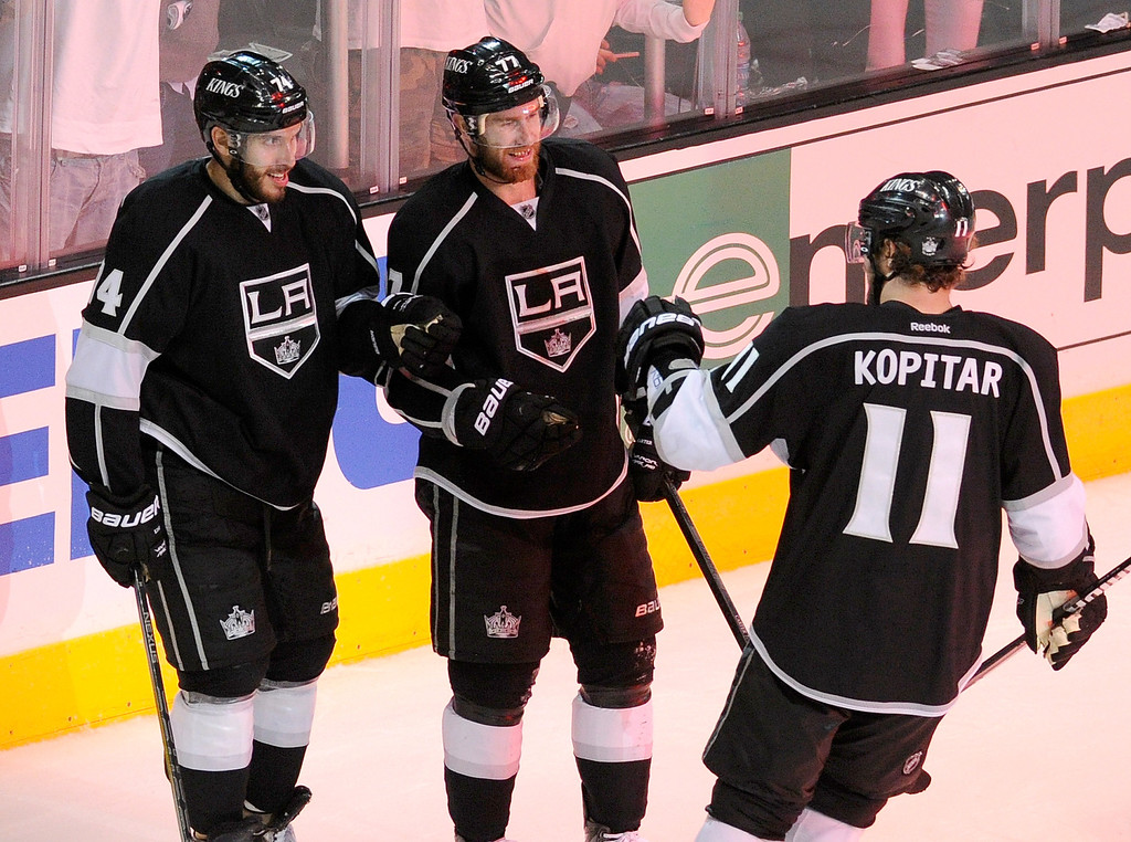 . Kings#74 Dwight King is congratulated by Kings#77 Jeff Carter and Kings#11 Anze Kopitar after he scored an empty net goal in the 3rd period. The Kings defeated the Chicago Blackhawks in the 3-1 in the 3rd game of the Western Conference Finals. Los Angeles, CA 6/4/2013(John McCoy/LA Daily News4