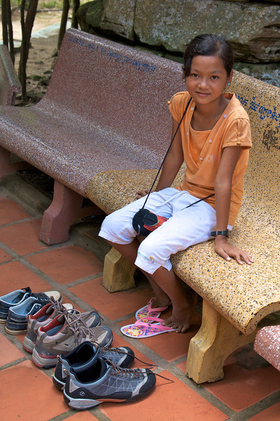 Phnom Kulen area. We paid her to watch our shoes while we wnet into the temple