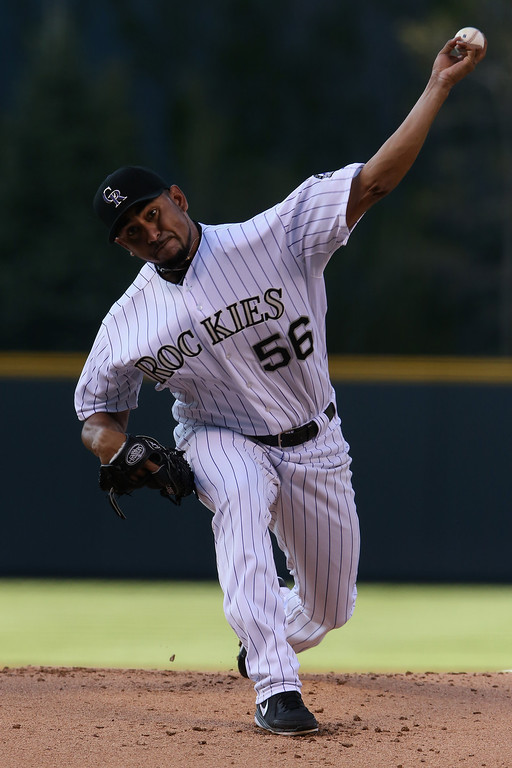 . DENVER, CO - MAY 03:  Starting pitcher Franklin Morales #56 of the Colorado Rockies delivers against the New York Mets at Coors Field on May 3, 2014 in Denver, Colorado.  (Photo by Doug Pensinger/Getty Images)