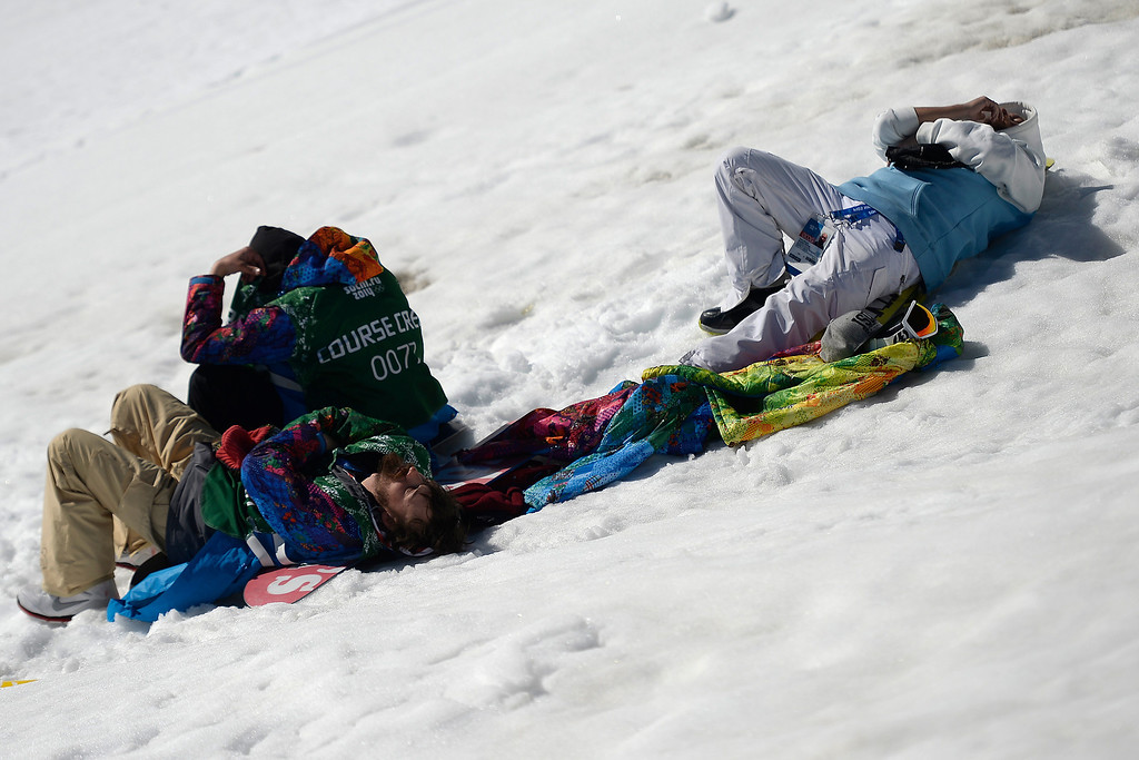 . The help rests in the sun during the men\'s ski slopestyle final at the Rosa Khutor Extreme Park. Sochi 2014 Winter Olympics on Thursday, February 13, 2014. (Photo by AAron Ontiveroz/The Denver Post)