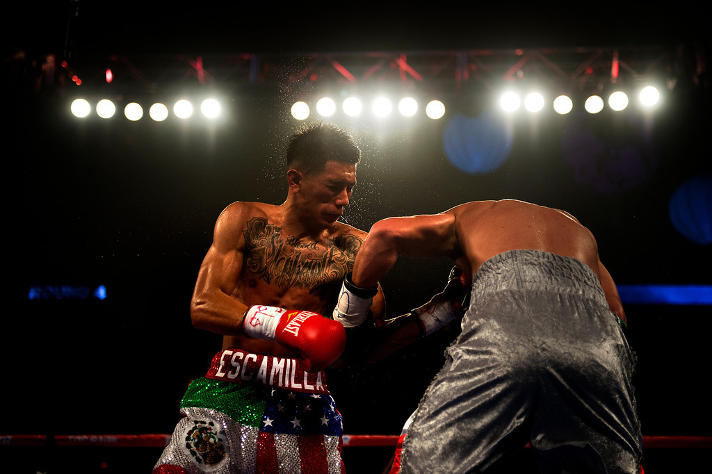 . BROOMFIELD, CO. - October 19: David Escamilla and Jair Quintero trade punches during their fight at the 1st Bank Center October 19, 2013 Broomfield, Colorado. (Photo By Joe Amon/The Denver Post)