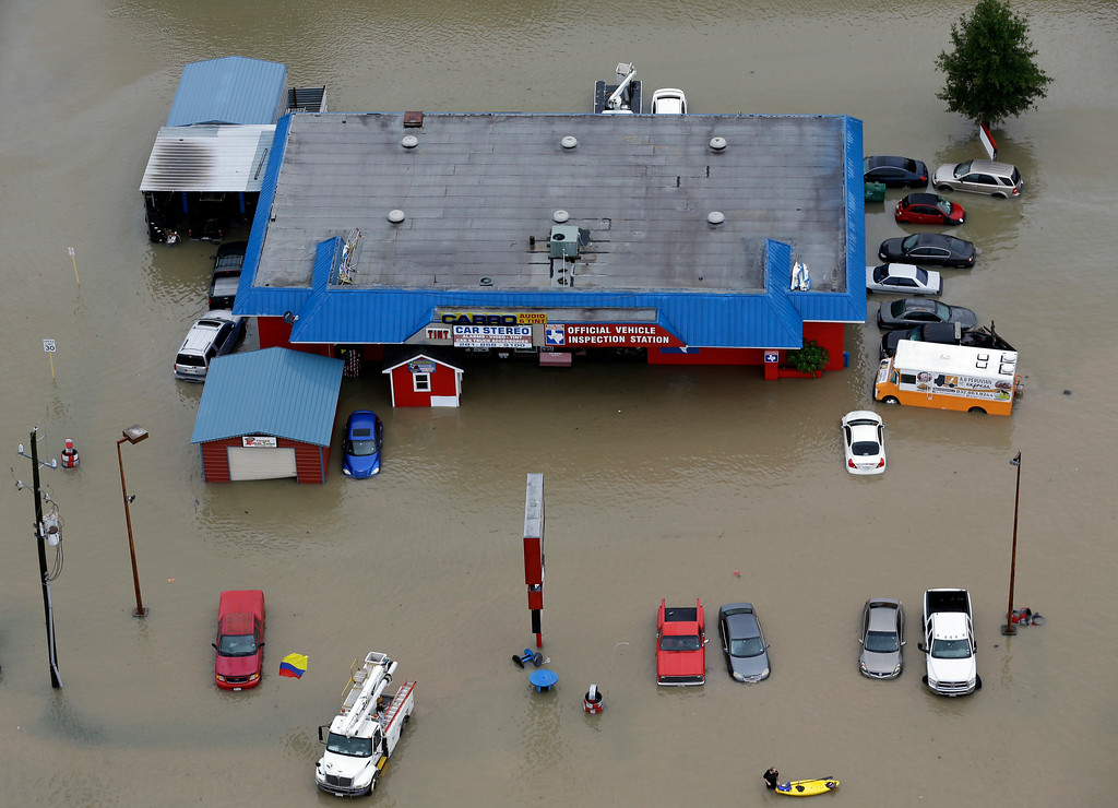 . Businesses and cars are flooded near the Addicks Reservoir as floodwaters from Tropical Storm Harvey rise Tuesday, Aug. 29, 2017, in Houston. (AP Photo/David J. Phillip)