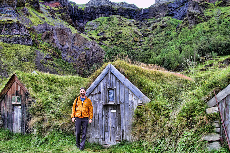 Brad in front of one of Iceland's turf houses