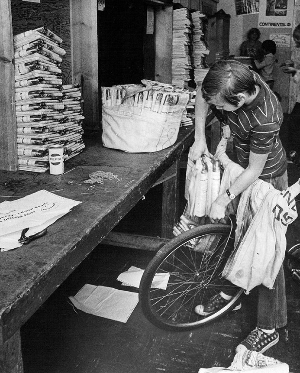 . Don Sprouse packs the folded newspapers Neatly and securely into his Bicycle Bags. October 1973.  (Photo by Ira Gay Sealy/The Denver Post Archive)
