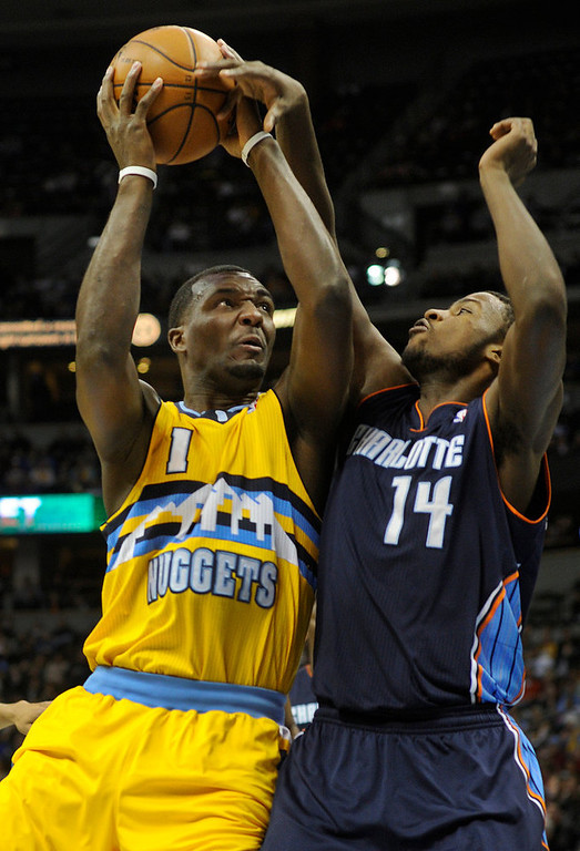 . Charlotte forward Michael Kidd-Gilchrist (14) tried to slow down Denver forward Jordan Hamilton (1) in the second half. The Denver Nuggets defeated the Charlotte Bobcats 110-88 at the Pepsi Center Saturday night, December 22, 2012.  Karl Gehring/The Denver Post