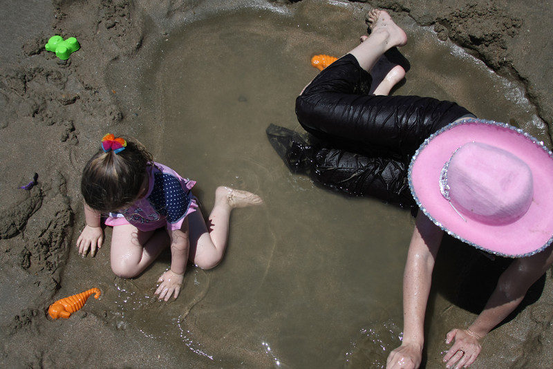 Mother and daughter playing in the sand. Photo by Trent Williams