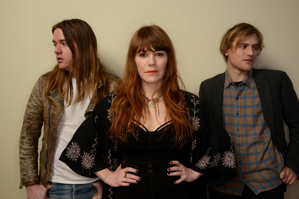 . (L-R) Musicians Johnathan Rice and Jenny Lewis and actor Johnny Flynn pose for a portrait during the 2014 Sundance Film Festival at the Getty Images Portrait Studio at the Village At The Lift on January 20, 2014 in Park City, Utah.  (Photo by Larry Busacca/Getty Images)