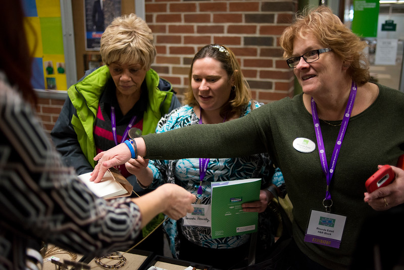 "LANCASTER, OHIO   MARCH 23, 2018: (l to r) Cindy Rager, Amanda Kennedy and Rhonda Estell talk to Lisa Gillespie, owner of Trades of Hope, a business that helps empower women out of poverty, abuse and sex trafficking through creation of fair trade jobs, at her booth during the Celebrate Women Conference 2018, themed ""Recognizing Our Superpowers"" on March 23, 2018 at Ohio University Lancaster in Lancaster, Ohio.  Ty Wright photo"