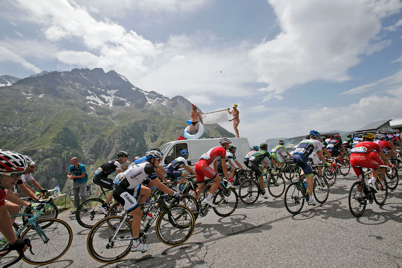 . The pack climbs towards Lautaret pass during the fourteenth stage of the Tour de France cycling race over 177 kilometers (110 miles) with start in Grenoble and finish in Risoul, France, Saturday, July 19, 2014. (AP Photo/Christophe Ena)