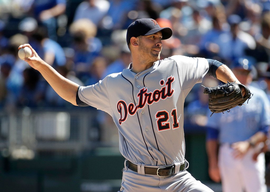 . Detroit Tigers starting pitcher Rick Porcello throws during the first inning of a baseball game against the Kansas City Royals, Sunday, Sept. 21, 2014, in Kansas City, Mo. (AP Photo/Charlie Riedel)