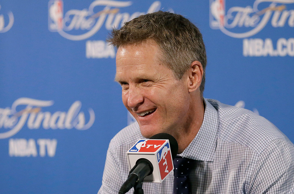 . Golden State Warriors head coach Steve Kerr smiles during a news conference after Game 1 of basketball\'s NBA Finals against the Cleveland Cavaliers in Oakland, Calif., Thursday, June 4, 2015. The Warriors won 108-100. (AP Photo/Ben Margot)