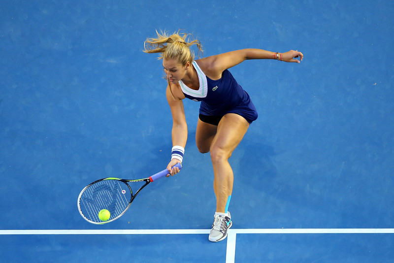 . Dominika Cibulkova of Slovakia plays a forehand in her women\'s final match against Na Li of China during day 13 of the 2014 Australian Open at Melbourne Park on January 25, 2014 in Melbourne, Australia.  (Photo by Quinn Rooney/Getty Images)