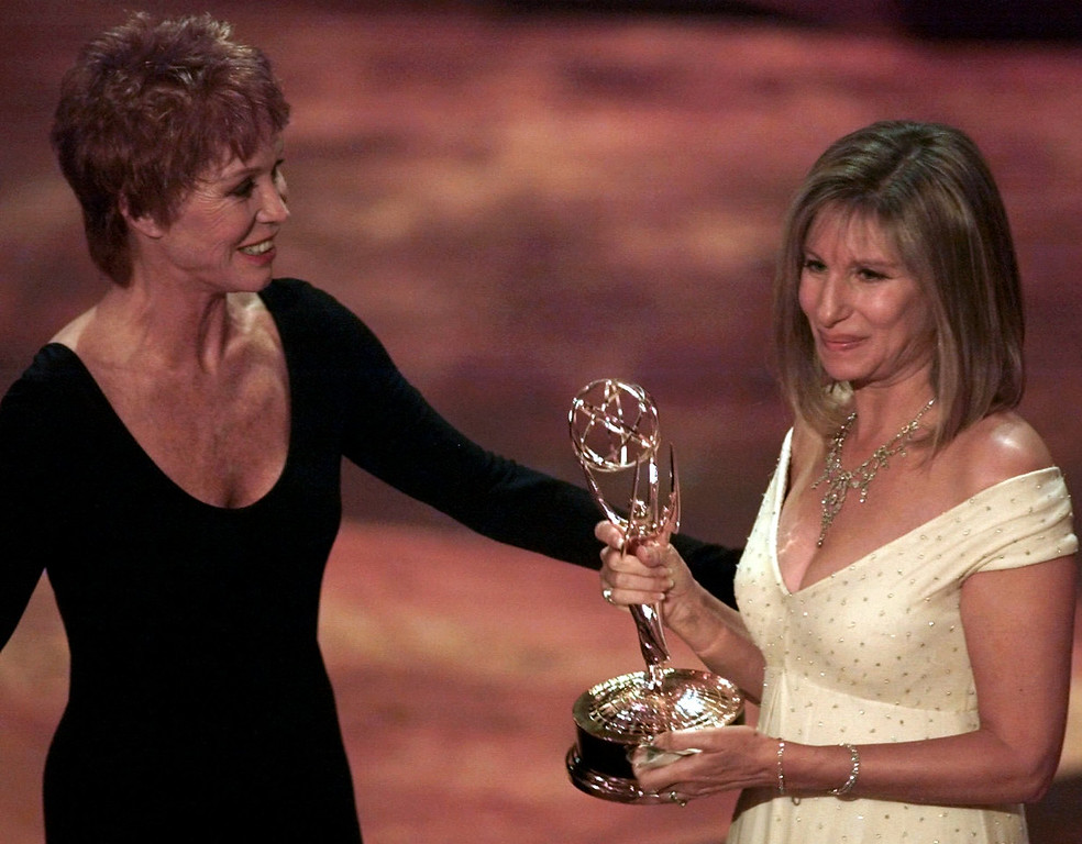 """. Mary Tyler Moore, left, presents Barbra Streisand with the Emmy for Outstanding Individual Performance in a Variety or Music Program for Streisand\'s appearance in \""""Barbra Streisand The Concert\"""" during the 47th annual Emmy Awards, Sunday, Sept. 10, 1995, in Pasadena, Calif. (AP Photo/Eric Draper)"""