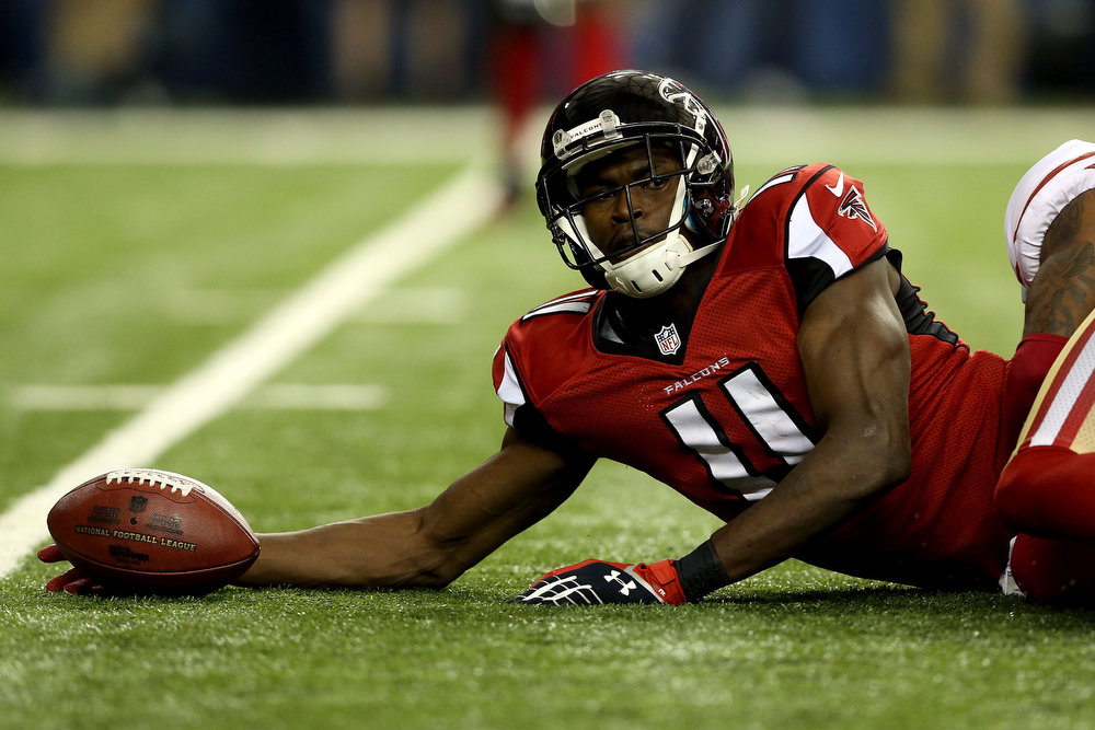 . Wide receiver Julio Jones #11 of the Atlanta Falcons looks on after making a catch in the second quarter against the San Francisco 49ers in the NFC Championship game at the Georgia Dome on January 20, 2013 in Atlanta, Georgia.  (Photo by Streeter Lecka/Getty Images)