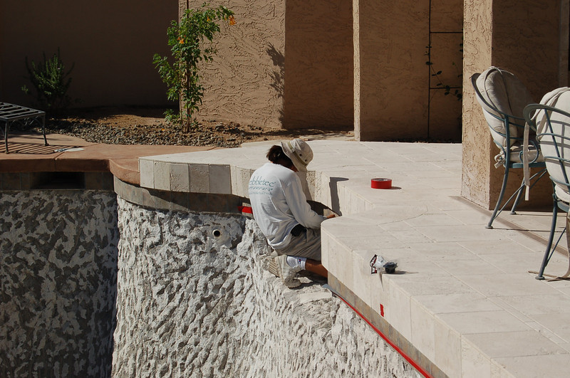 And taping off the tile.