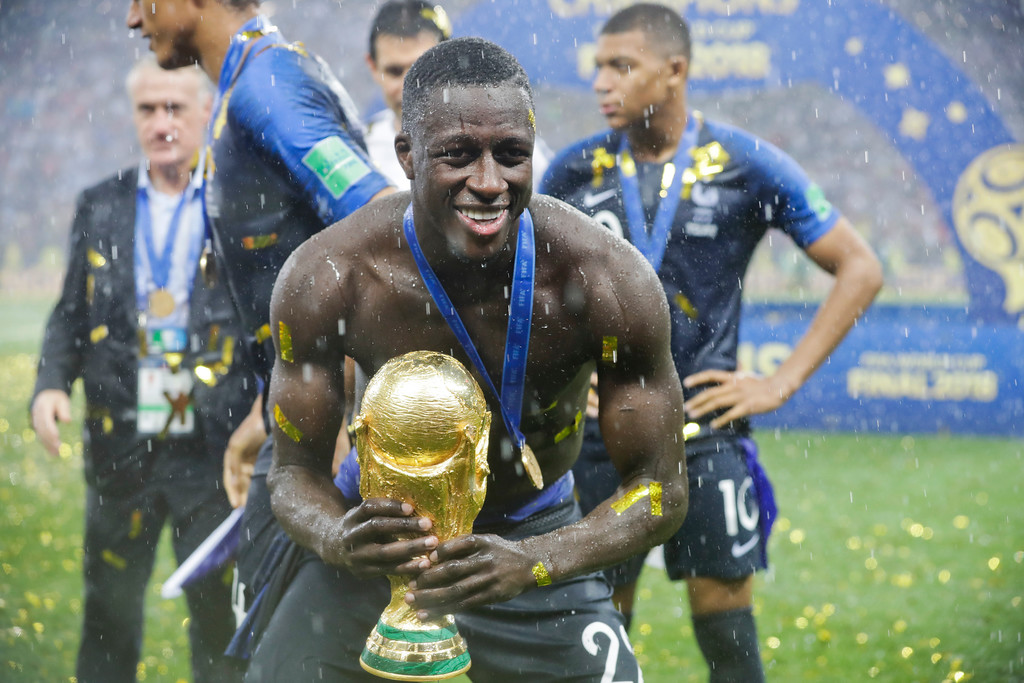 . France\'s Benjamin Mendy holds the trophy at the end of the final match between France and Croatia at the 2018 soccer World Cup in the Luzhniki Stadium in Moscow, Russia, Sunday, July 15, 2018. (AP Photo/Matthias Schrader)