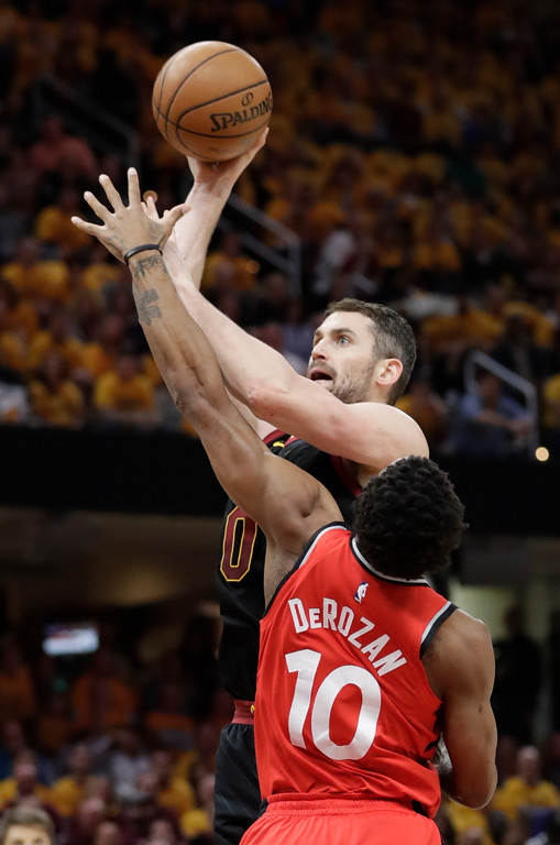 . Cleveland Cavaliers\' Kevin Love shoots over Toronto Raptors\' DeMar DeRozan (10) in the first half of Game 4 of an NBA basketball second-round playoff series, Monday, May 7, 2018, in Cleveland. (AP Photo/Tony Dejak)
