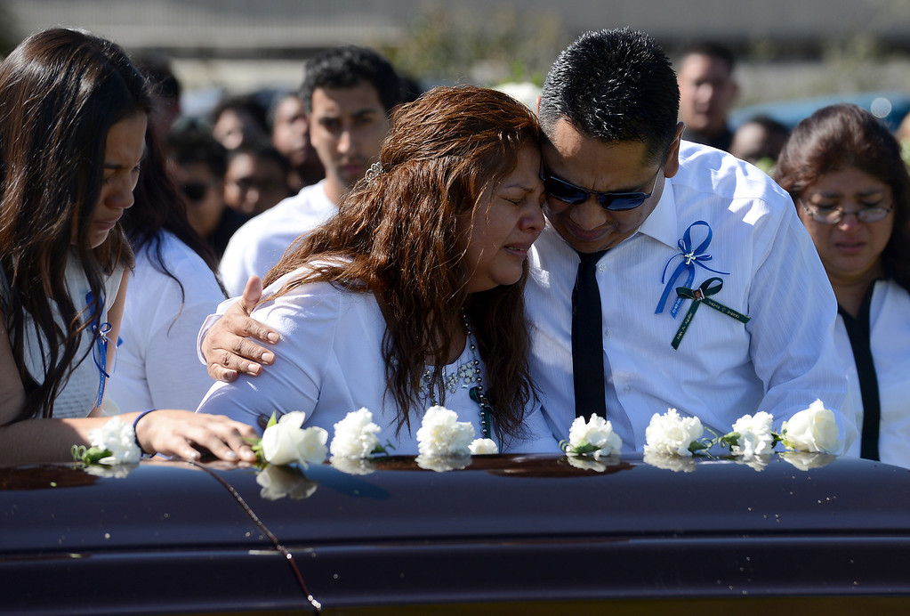 . 0315_IDB-L-AGUILAR-01-JCM (Jennifer Cappuccio Maher/Staff Photographer) Argelia and Raul Aguilar mourn at the casket for their son, Ivan Arturo Aguilar, during funeral services Thursday, March 14, 2013, at Oakdale Memorial Park in Glendora. Aguilar was hit and killed by a car while riding his bike on campus at Cal Poly Pomona in Pomona.