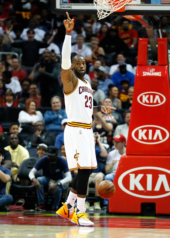. Cleveland Cavaliers forward LeBron James (23) reacts after scoring in the first half of an NBA basketball game against the Atlanta Hawks, Sunday, April 9, 2017, in Atlanta. (AP Photo/Todd Kirkland)