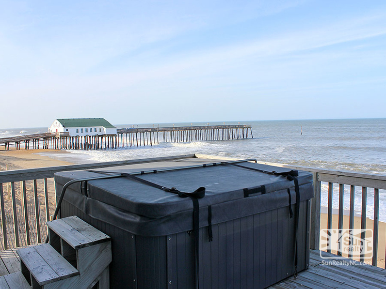 Oceanfront Deck with Hot Tub and View of Hilton Garden Inn Pier