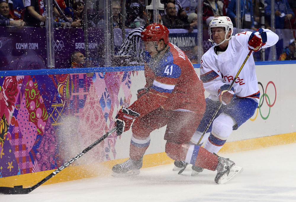 . Norway\'s Mats Trygg (R) vies with Russia\'s Nikolai Kulyomin during the Men\'s Ice Hockey play-offs qualification match Russia vs Norway at the Bolshoy Ice Dome during the Sochi Winter Olympics on February 18, 2014. (JONATHAN NACKSTRAND/AFP/Getty Images)