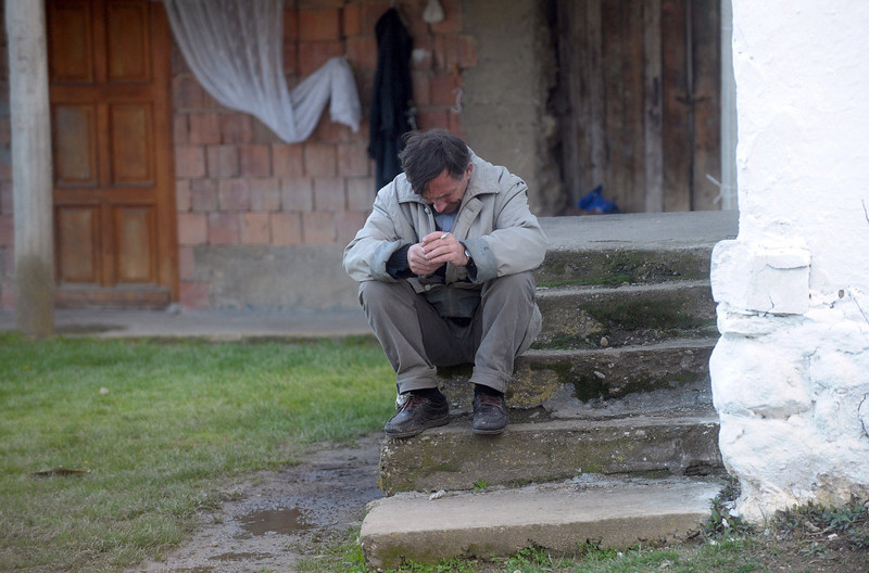 . Radoslav Stekic, the relative of a victim of a shooting, cries in the village of Velika Ivanca, 40 kilometers south of capital Belgrade, on April 9, 2013. A man shot dead 13 relatives and neighbors, including a two-year-old child, in a tiny Serbian village on Tuesday, in the country\'s worst killing spree in two decades.  AFP PHOTO / ALEXA STANKOVIC