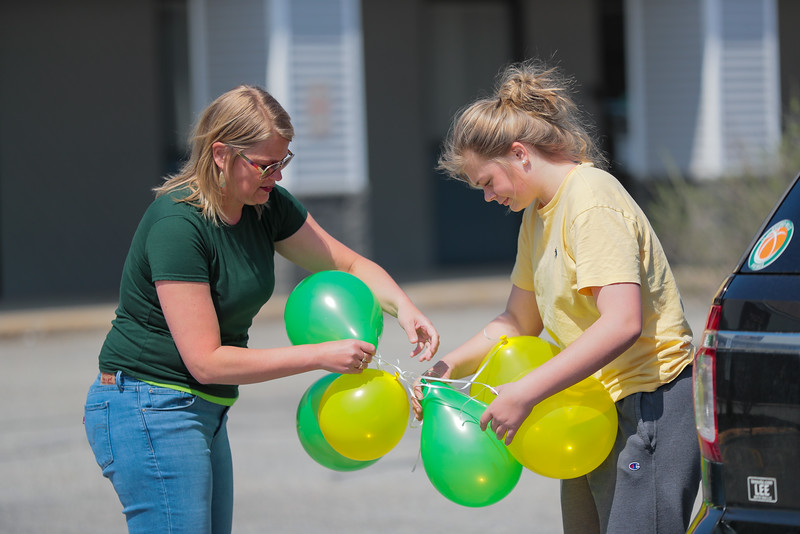Sydni Smith (right) and her mother Sonia untable some baloons in the Flagship Cinema parking lot before the parade.