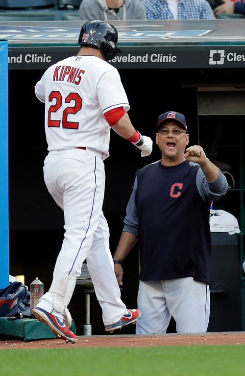 . Cleveland Indians\' Jason Kipnis is congratulated by Cleveland Indians manager Terry Francona after Kipnis hit a solo home run off Oakland Athletics starting pitcher Sonny Gray in the fifth inning of a baseball game, Tuesday, May 30, 2017, in Cleveland. (AP Photo/Tony Dejak)