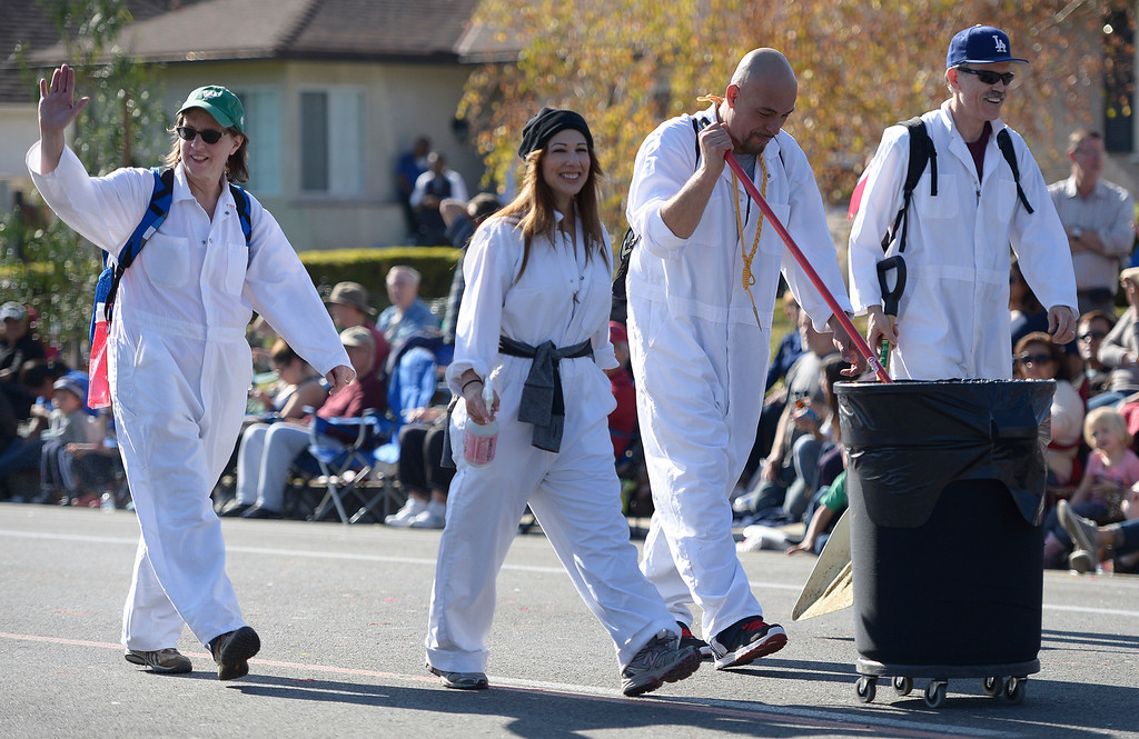 . To many participants marching in the parade, these guys are their favorite. The scoopers are seen near the end of the parade route during the 2014 Rose Parade in Pasadena, CA January 1, 2014.(John McCoy/Los Angeles Daily News)