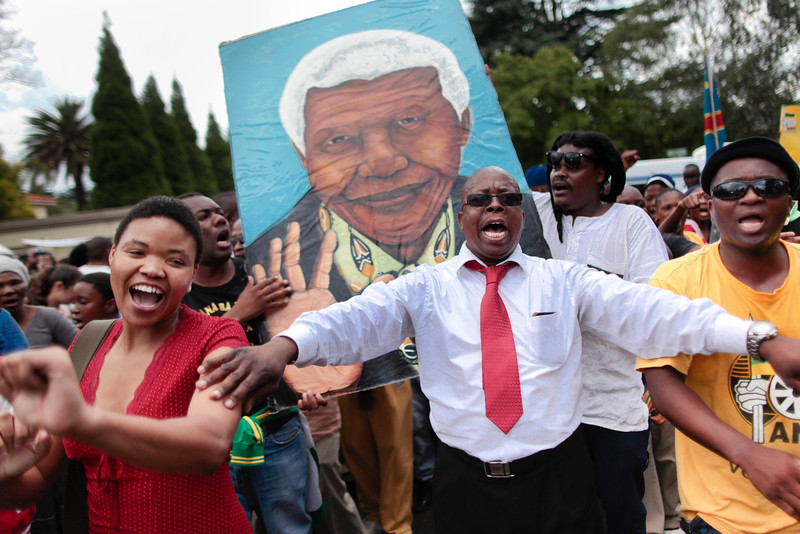 . Mourners sing and dance to celebrate the life of the late South African president Nelson Mandela outside his home in Johannesburg, South Africa, 06 December 2013. Nobel Peace Prize winner Nelson Mandela died at age 95, in Johannesburg, South Africa, on 05 December 2013. A former lawyer, Mandela was the first black President of South Africa voted into power after the countries first free and fair democratic elections that witnessed the end of the Apartheid system in 1994. Mandela was founding member of the ANC (African National Congress) and anti-apartheid activist who served 27 years in prison, spending many of these years on Robben Island. In South Africa, Mandela is often known as Tata Madiba, an honorary title adopted by elders of Mandela\'s clan. Mandela won the Nobel Peace Prize in 1993.  EPA/DAI KUROKAWA