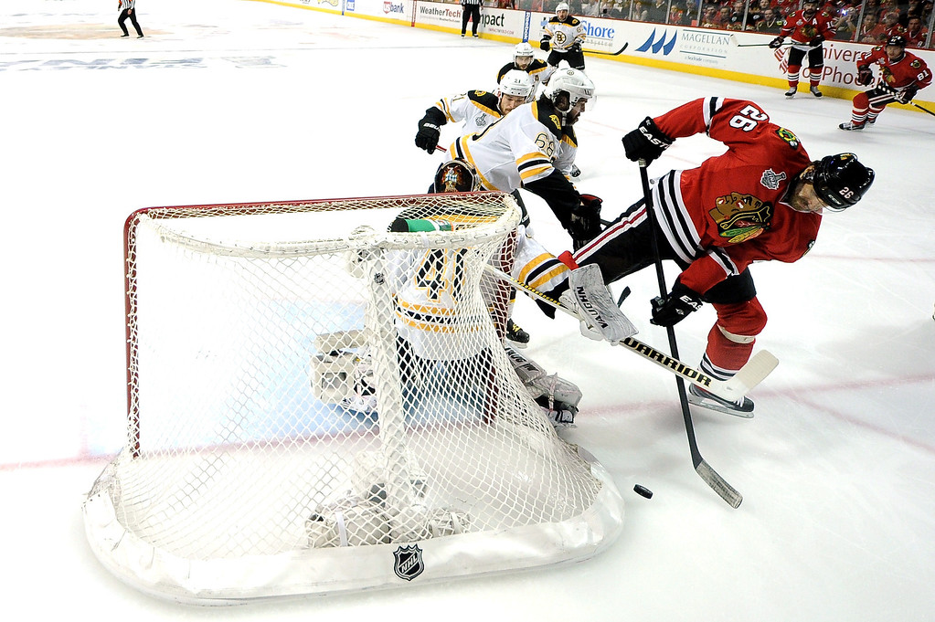 . CHICAGO, IL - JUNE 22:  Michal Handzus #26 of the Chicago Blackhawks takes a shot on Tuukka Rask #40 of the Boston Bruins in Game Five of the 2013 NHL Stanley Cup Final at United Center on June 22, 2013 in Chicago, Illinois.  (Photo by Harry How/Getty Images)