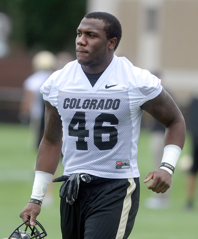 . University of Colorado\'s Christian Powell runs on to the field during the second fall football practice on Wednesday, Aug. 7, at the CU practice fields. For more photos of practice go to www.dailycamera.com Jeremy Papasso/Camera
