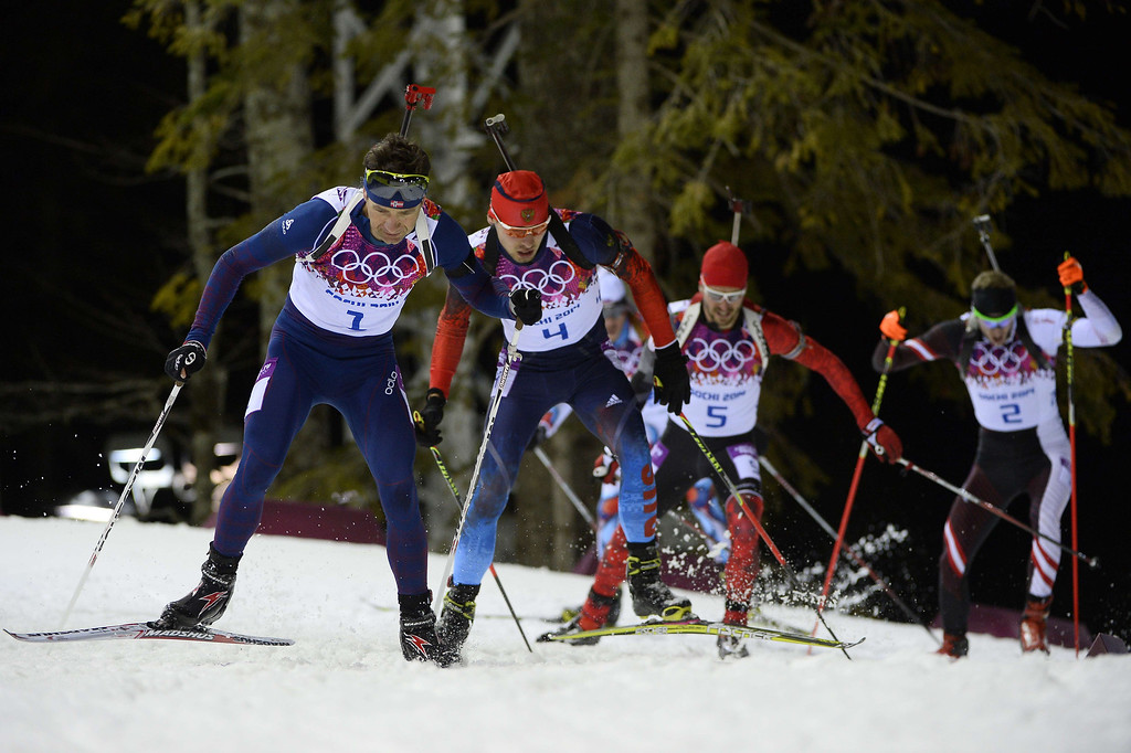 . From left, Norway\'s Ole Einar Bjoerndalen, Russia\'s Anton Shipulin, Canada\'s Jean-Philippe le Guellec and Austria\'s Dominik Landertinger compete in the Men\'s Biathlon 12,5 km Pursuit at the Laura Cross-Country Ski and Biathlon Center during the Sochi Winter Olympics on February 10, 2014 in Rosa Khutor near Sochi.   PIERRE-PHILIPPE MARCOU/AFP/Getty Images