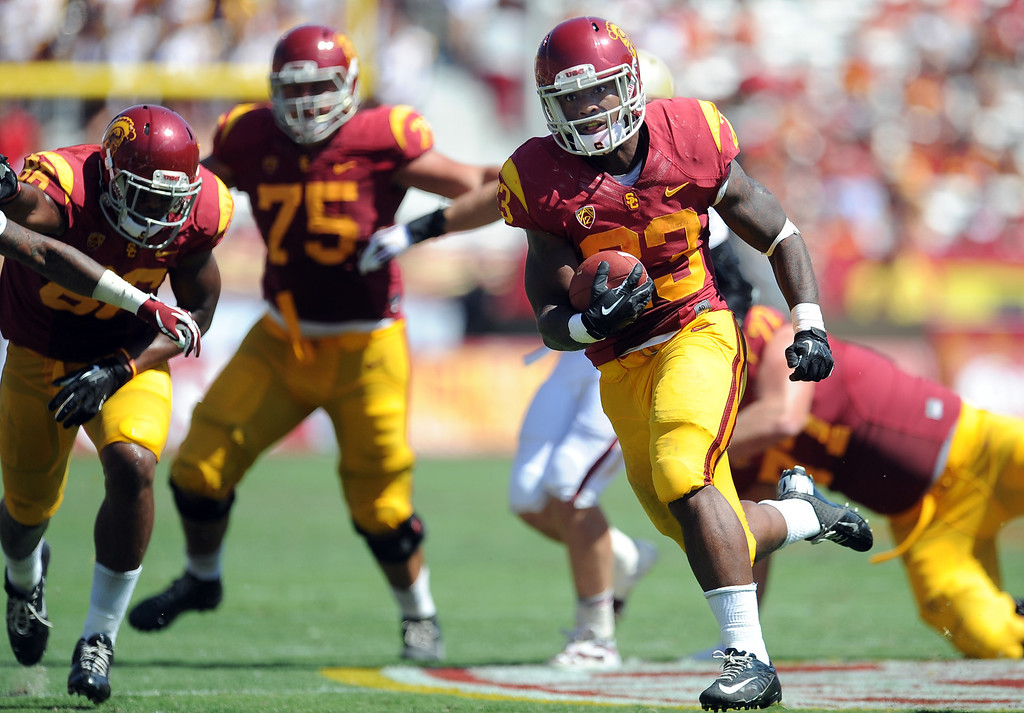 . USC 35, BOSTON COLLEGE 7<br /> Sept. 14, 2013; Los Angeles Memorial Coliseum After being tabbed as the Trojans\' starting quarterback, Cody Kessler threw for 237 yards and two touchdowns in leading a 521-yard outburst for USC (2-1). Tre Madden ran 16 times for 102 yards, becoming the first USC player to start a season with three consecutive 100-yard rushing games since 1971. Justin Davis added 96 yards on 10 carries. Boston College (2-1) was held to just 184 yards, and tailback Andre Williams, who had run for 318 yards in two games, was limited to just 38 yards on 17 carries.   (Photo by Keith Birmingham/Pasadena Star-News)