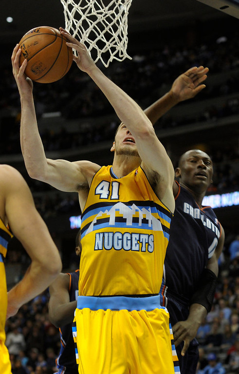 . Denver center Kosta Koufos (41) worked under the basket in the second half. The Denver Nuggets defeated the Charlotte Bobcats 110-88 at the Pepsi Center Saturday night, December 22, 2012.  Karl Gehring/The Denver Post
