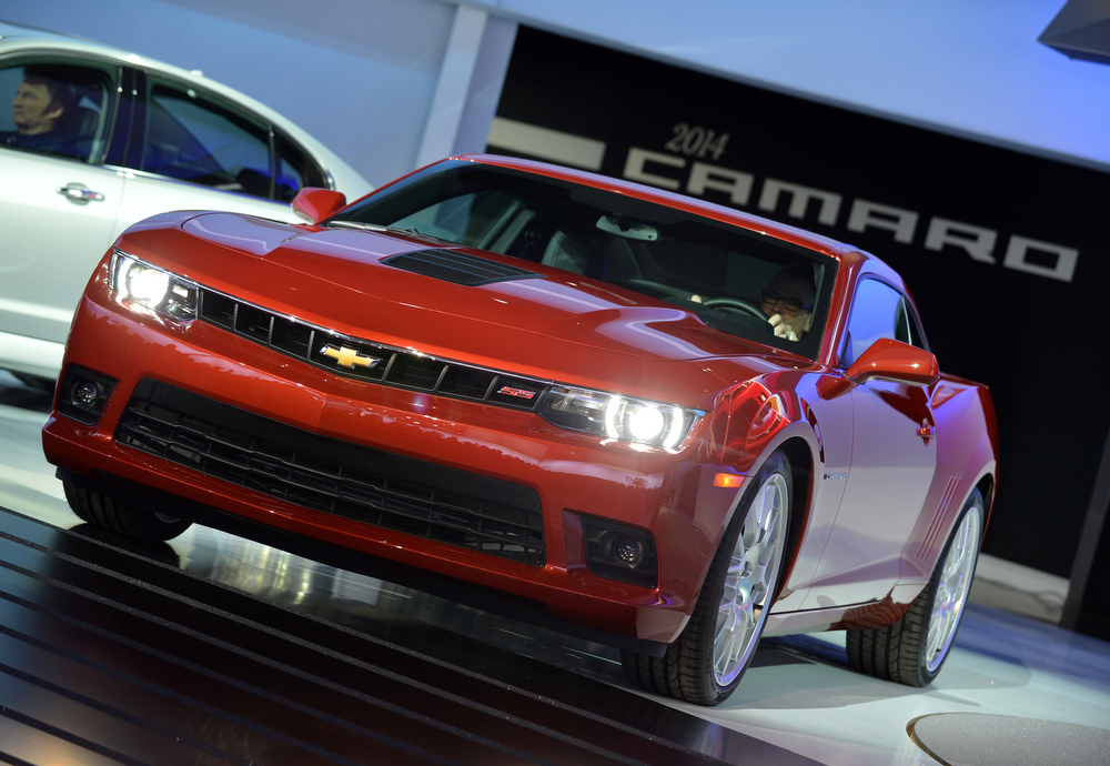 Description of . The 2014 Chevrolet Camaro is unveiled during the first press preview day at the New York International Auto Show March 27, 2013 in New York.  STAN HONDA/AFP/Getty Images