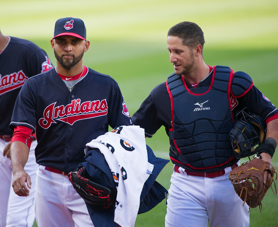 . Cleveland Indians pitcher Danny Salazar, left and Yan Gomes walk to the dugout, before a baseball game against the Seattle Mariners, in Cleveland, Wednesday, April 20, 2016. (AP Photo/Phil Long)